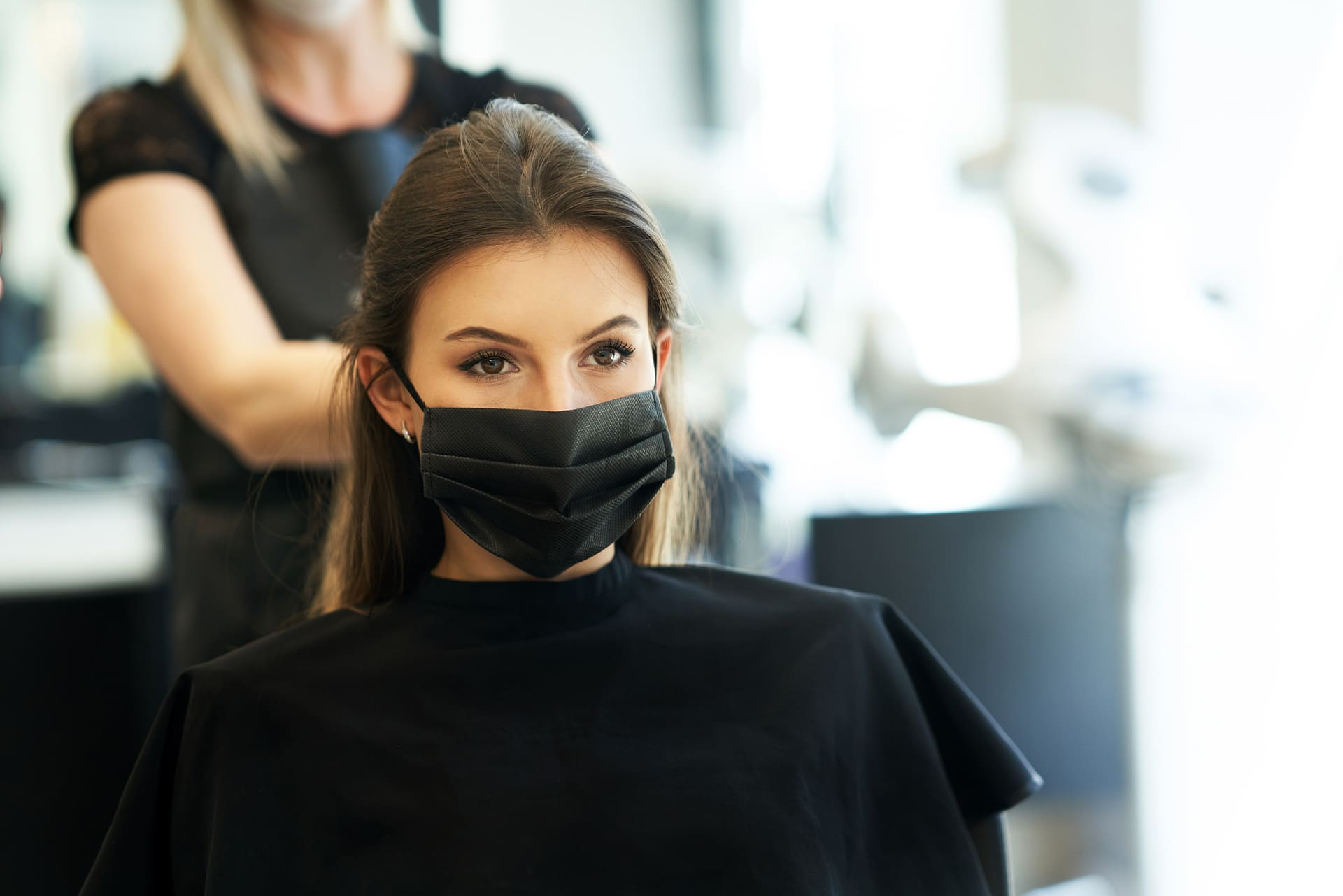 Woman during hair appointment.